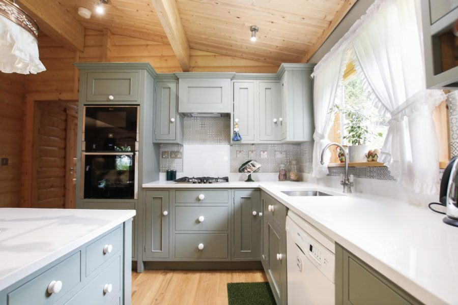 This kitchen utilises the natural light coming through the window to brighten the space. Bespoke kitchen created for our customer who lives in a log cabin the Staffordshire countryside. Handmade by Mudd & Co
