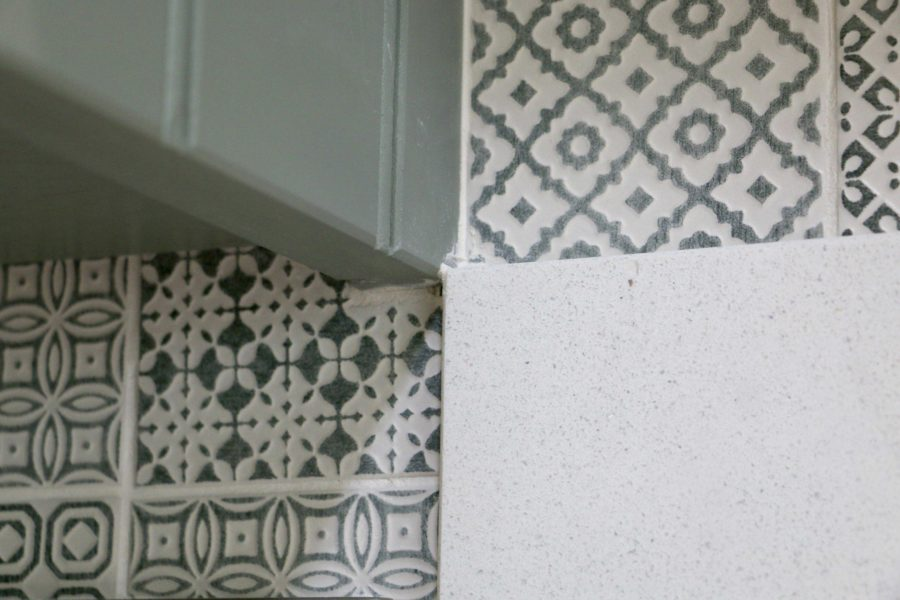 The delicate green patterned tiles that Joy chose formed the base for the main colours in the kitchen. Bespoke kitchen, customer case study in a log cabin the Staffordshire countryside. Handmade by Mudd & Co
