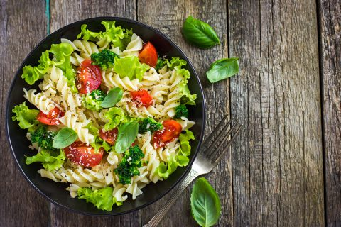 Back-to-school lunch box ideas: Pasta salad with cherry tomatoes and broccoli, top view