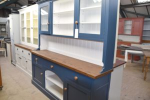 This seven foot dog kennel dresser is hand painted in Farrow & Ball Stiffkey Blue with a waxed worktop and glazed cupboards. Hand crafted by Mudd & Co.