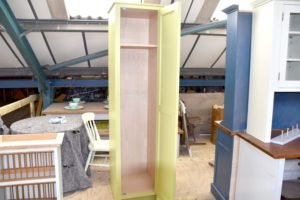 This cleaner's cupboard is hand painted in Little Greene Lime Green and has an oak knob handle. Hand crafted by Mudd & Co.